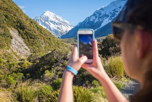 How many people use mobile phones in New Zealand?